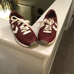 Gently used burgundy real leather converse